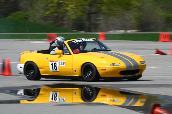 yellow Miata at RIT SCCA FLR autocross 2008